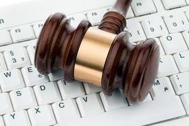stock photo of groping  - gavel and keyboard - JPG
