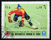 YEMEN CIRCA 1968: A stamp printed in Yemen shows Winter Olympic games in Grenoble, circa 1968