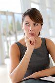 Portrait of businesswoman with doubtful look