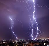 stock photo of thunder-storm  - Photo of beautiful powerful lightning over big city - JPG