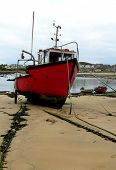 stock photo of hughes  - a red fishing boat at Hugh Town harbour St - JPG