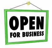 The words Open for Business on a sign that would hang on the wall or in a window of a shop, store or