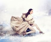 stock photo of snow queen  - Fashion Beautiful Winter Woman in Luxury Fur Mink Coat - JPG