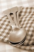 old silver spoons, sepia toned