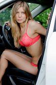 The sexual girl in bikini with car