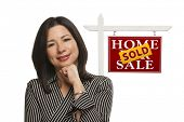 pic of real-estate-team  - Ethnic Woman in Front of Sold Home For Sale Real Estate Sign Isolated on a White Background - JPG