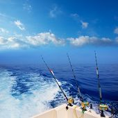 boat fishing trolling in deep blue ocean offshore in Mediterranean sea