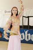TULSA, OK - OCT 20: A member of Purple Roses of Cairo dance group performs at Oktoberfest in TULSA, OK, on October 20, 2012 in TULSA, OK.