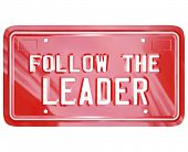 A red license plate with the words Follow the Leader to symbolize leadership, wisdom, mentoring and lessons learned to succeed in life, business or achieving a goal