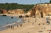 PORTIMAO, PORTUGAL - OCT 16: Tourists and locals enjoy the mild temperatures along the beach area known as Praia da Rocha on October 16, 2012 in Portimao, Portugal.