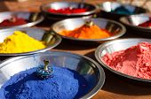 India symbol. Colored colorful powder kumkum in bowls on Indian bazaar for Holi and other festivals