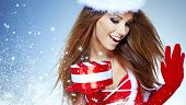 beautiful sexy girl wearing santa claus clothes  with christmas gift