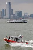 NEW YORK CITY, USA - JUNE 10: U.S. Coast Guard boat patrolling in front of Manhattan. June 10, 2012 in New York City, USA