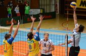 KAPOSVAR, HUNGARY - OCTOBER 5: Andras Geiger (R) in action at a Middle European League volleyball ga