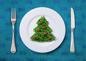 Christmas salad on white plate with knife and fork