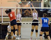 BUDAPEST, HUNGARY - OCTOBER 10: Unidentified players in action at the Hungarian I. League volleyball game Kaposvar (white) vs Budai XI (red), October 10, 2012 in Budapest, Hungary.