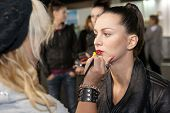 ZAGREB, CROATIA - OCTOBER 10: Fashion model prepares in backstage for Couture show by Marina Design