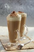 Coffee Latte Macchiato With Cream In Glasses On Window Background