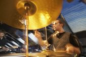 stock photo of drum-kit  - View of a male drummer in performance - JPG