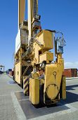 Mobile crane moving containers in stockyard at Limassol Cyprus
