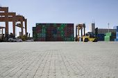 View of stacked containers and cranes in stockyard at Limassol Cyprus