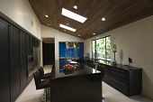 Breakfast bar in modern kitchen with skylights
