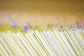 Closeup of colour coded filing system for folders