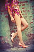 woman  long legs in  high heel shoes and summer dress outdoor shot