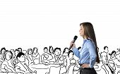 stock photo of public speaking  - Beautiful business woman is speaking on conference - JPG