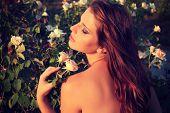 woman sensual look in the garden in summer. vintage photo