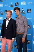 LOS ANGELES - JUL 31:  Jesse Tyler Ferguson, Justin Mikita arrives at the 2013 Do Something Awards a