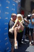 LOS ANGELES - JUL 31:  Doug Hutchison, Courtney Stodden at the PETA Pink's Veggie Hot Dog Event at the Hollywood & Highland on July 31, 2013 in Los Angeles, CA