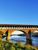 stock photo of carthusian  - Ponte Coperto bridge in Pavia Lombardy Italy - JPG