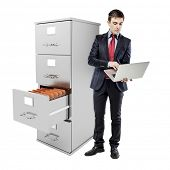 business man with laptop standing near a 3d file cabinet, on whtie background