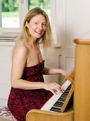 Beautiful Blond Playing The Piano At Home