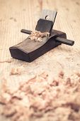 Small Wood Planer And Shavings Closeup