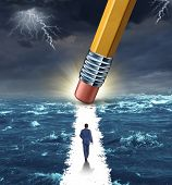 stock photo of pencil eraser  - Freedom concept with a lightning storm at sea and a pencil erasing a clear path for a businessman to walk to his success goal as a metaphor for bridge building solutions and overcoming adversity - JPG