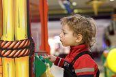 Child At Game Amusement Park