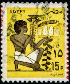 EGYPT - CIRCA 1985: A stamp printed by Egypt, shows Slave bearing votive fruit offering mural, circa