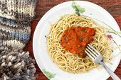 Plate Of Spaghetti And Sauce With A Winter Hat