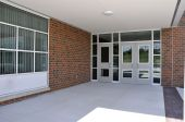 stock photo of school building  - several entry doors for a modern school - JPG