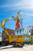 VALENCIA, SPAIN - MARCH 2013: Fallas of Valencia is a popular fest with humor figures on streets that will burn in March 19 night, Valencia, Spain March 2013. Crane constrution of Nou Campanar Falla