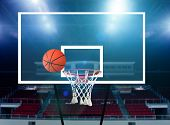 picture of missing  - Glass basketball board and hoop with a missed shot - JPG
