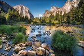 stock photo of reflection  - Yosemite valley reflected on the river at sunset - JPG