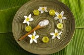 spa supplies frangipani with. Salt in spoon,candle image of tropical spa.