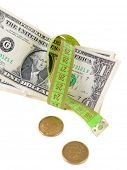 Tape measure with money isolated on white