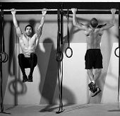 stock photo of toe  - Crossfit toes to bar men pull - JPG