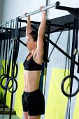 Crossfit toes to bar woman pull-ups 2 bars workout exercise at gym