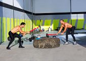Crossfit sledge hammer men workout at gym