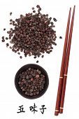 Schisandra berries chinese herbal medicine with chopsticks and mandarin script title translation. Wu